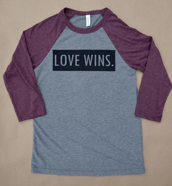 love wins unisex 3/4 sleeve raglan