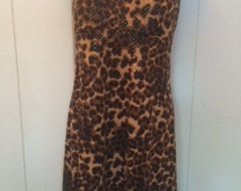 Fitted and flared slip style dress/cheetah print spandex