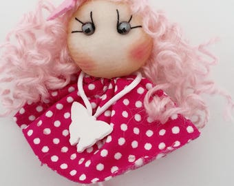 Little doll in pink soft to wear as a lapel pin or brooch