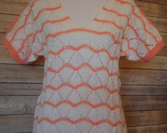 Cream and Peach short sleeved knit sweater. Size M