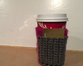 Crocheted fuchsia coffee cozie with pocket