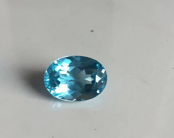 An oval shaped 18.80 carat blue topaz beautiful stone of 13x17 MM for a heavy necklace