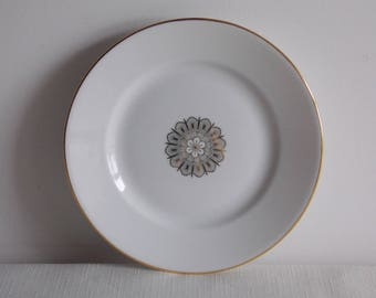 "A White side plate by""Limoges."""