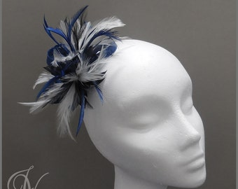 Delicate blue and white fascinator with sinamay loops and hackle feather. Weddings, race day, ladies day, special occasion.