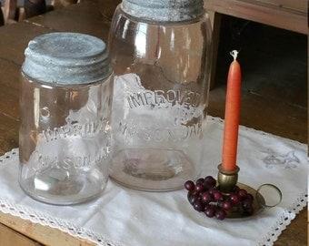 Antique mason jars two Improved Mason Jar's quart and pint fruit jar
