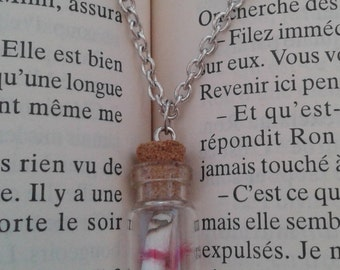 Necklace bottle thrown into the sea