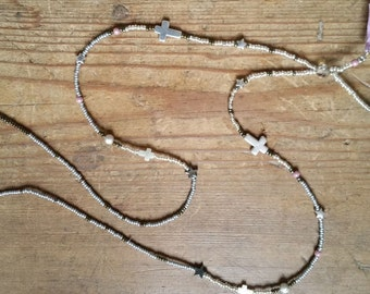 Necklace with metallic beads, little cross and tassels