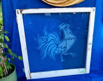 Beautiful sandblasted rooster design on a unique vintage window. The piece is truly unique and stunning. The rooster's pose is lovely