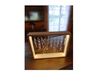 Bright contemporary sculpture made of plexiglas and wood frame cable