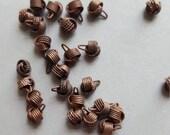 Vintage dark copper tiny knot charms