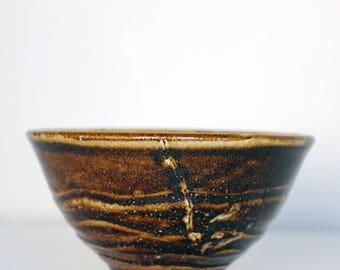 brown noodle bowl