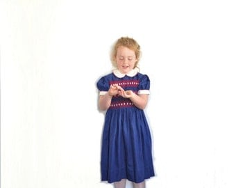1960 smocked little girl dress . peter pan collar . traditional navy blue red embroidery .sale