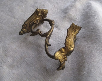 Antique French ormolu curtain tieback, holder.  Perfect for a door curtain; Coat, hat, robe hook.  Gilded, brass.