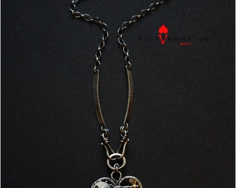 "Kinetic necklace ""Enigma"". Heart shaped. Interactive with a spin."