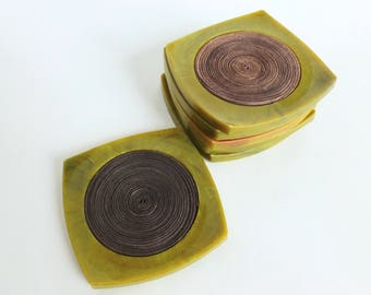 Bakelite Coaster Set Marbled Green Yellow with Raffia Centers Mid Century Tiki Barware