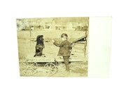 Dog Tricks Postcard. Real Photo. Boy Teaching Black Dog to Sit Up. Kids Wagon. 1910s Antique Americana Collectible