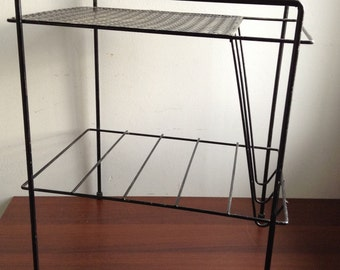 Vintage Black Metal Stand or rack.  Side Table.  Magazine, records, phone. Mid century modern, Kitsch, Eames era. 1950's.