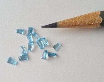 Blue topaz tapered baguette keystone stone