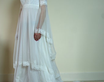 Vintage 1970s Romantic Bohemian Wedding Dress with Lace Sheer Layers in tiers and large angel sleeves Made in Great Britain