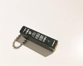 vintage little black book keychain