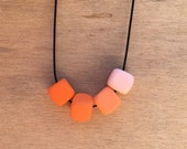 Square bead - 'squ-ound' necklace. Call me Dutch Orange. Polymer Clay / Resin with adjustable cord