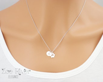 Personalized paw print necklace.  Dainty silver paw print and initial necklace