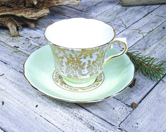 Vintage Royal Vale Bone China Teacup and Saucer in Mint Green and Gold on White