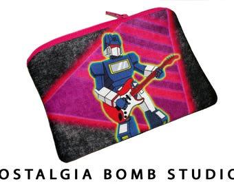 Cambiar de Soundwave de Transformers G1 en guitarra - bolsa de la cremallera, bolso, bolso del teléfono