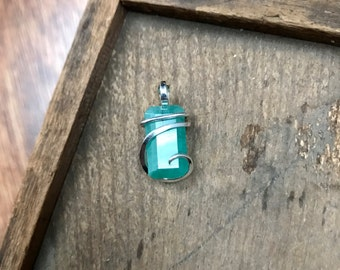 Faceted emerald in polished sterling silver pendant