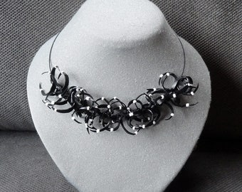 Black and white necklace from recycled bicycle inner tube.