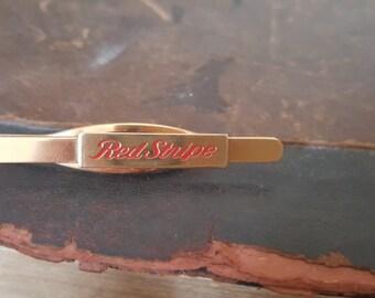"Vintage Gold Tone ""Red Stripe"" Beer Logo Tie Clip"