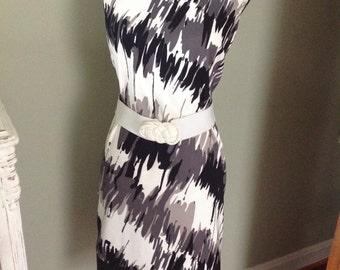 Black,white, and gray dress....inkblot design....sleeveless.... Belted....lace hem