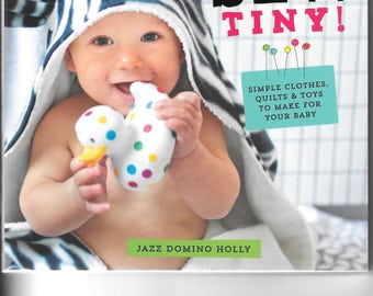 Beautiful book called 'sew tiny' by Jazz Domino Holly - simple clothes, quilts and toys to make for your baby.