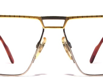 Vintage eyewear. Alberto Puccini frame. Made in Italy. 1980's. Gold and platinum color. Exceptional condition and quality! Modern.