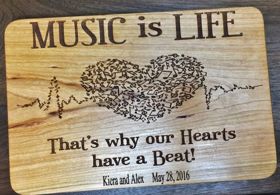 Personalized Music is Life Wood Cutting Board Engraved with Name in Cherry, White Oak, Maple, and Walnut Wood.