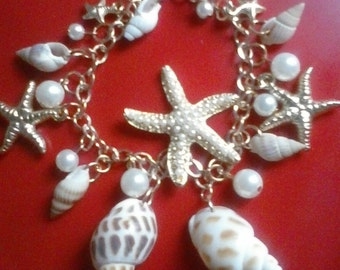 Beautiful shell, gold tone,  pearl beads, charm bracelet, adjustable chain,Free shipping