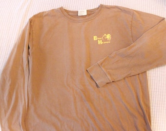 Vintage Blue Heaven Original Key West creamy brown shirt w/ yellow green brown and blue lettering/imaging.