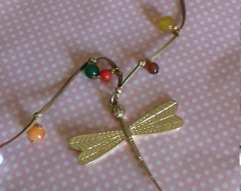 Dragonfly with natural stones and gold suede cord