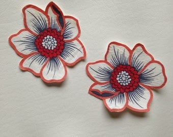 Two large mirror image flower patches
