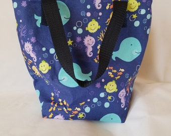 Insulated waterproof lunch bag with an ocean fish theme, perfect for kids or adults