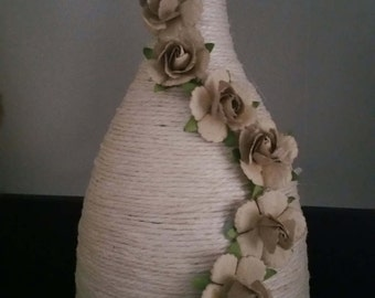 Shabby Chic Ivory Twine Wine Bottle with Beige Paper Rose Embellishments