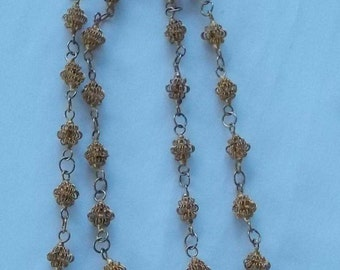 431.  Thirty inch lacey gold tone brass beaded necklace