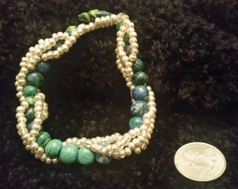 Teal Hand-rolled Clay Beads with Silver Glass Bead Spiral Bracelet