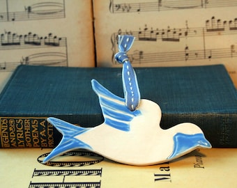 Blue Swallow Bird, with a nice blue & white glaze. Handmade pottery sent to you in a lovely gossamer bag ready to be given as a gift.