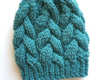 Teal braided cable hat with faux fur pom pom