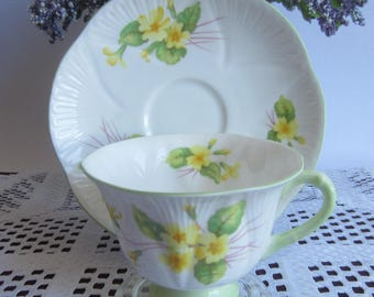 Shelley PRIMROSE 13430 with lovely Yellow flowers and light green handle Bone China Tea Cup and Saucer