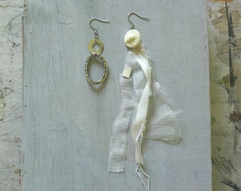 Dangling silver and white with recycled material