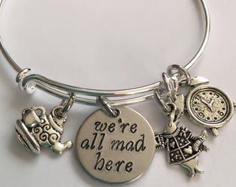 "Alice in wonderland Bracelet bangle bracelet adjustable bracelet-with rabbit clock tea kettle and cup and hand stamped ""we're all mad here"""