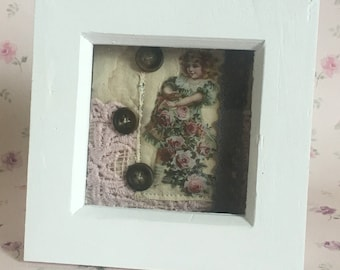 Mixed media vintage girl with flowers in frame