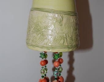 Handmade green beaded bell with cats.
